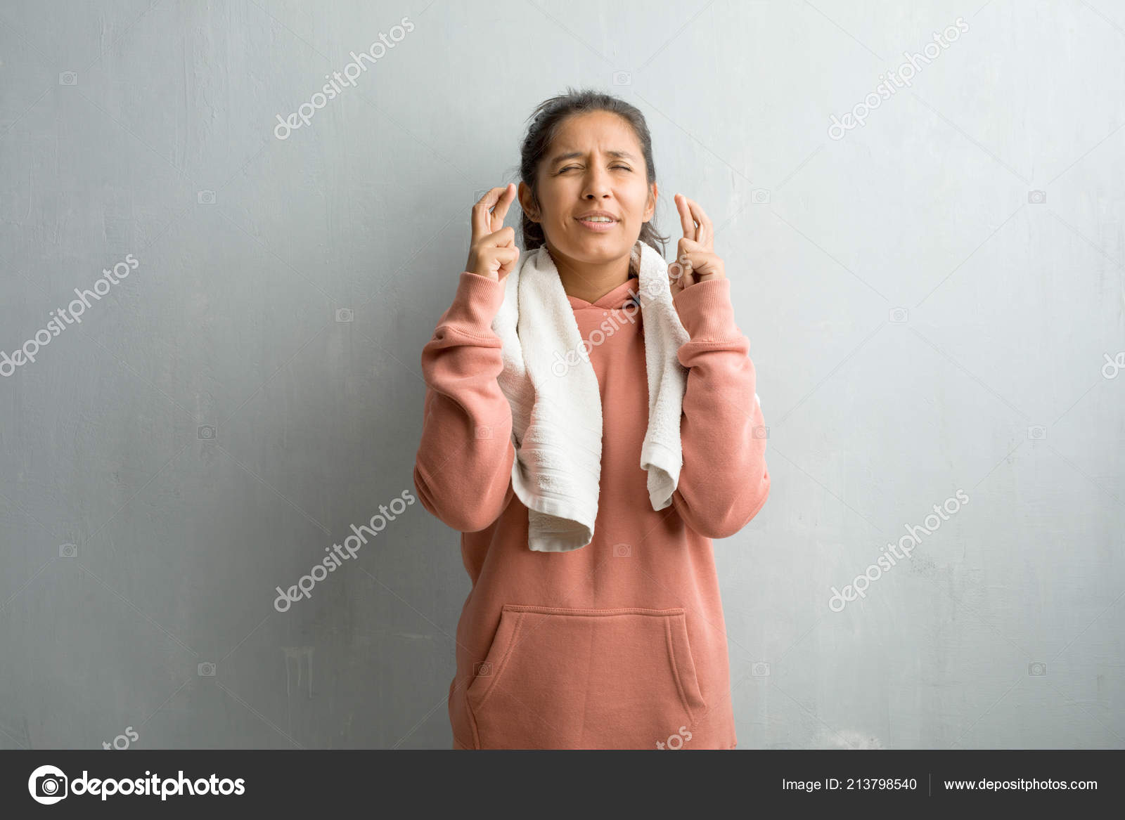 Young Sporty Indian Woman Wall Crossing His Fingers Wishes