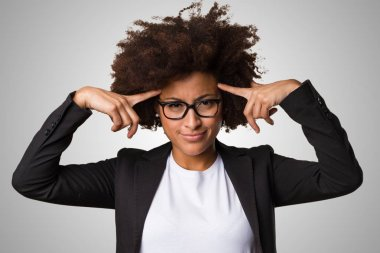 black business woman thinking on gray background