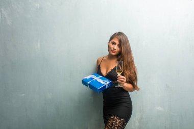 Young latin woman celebrating new year