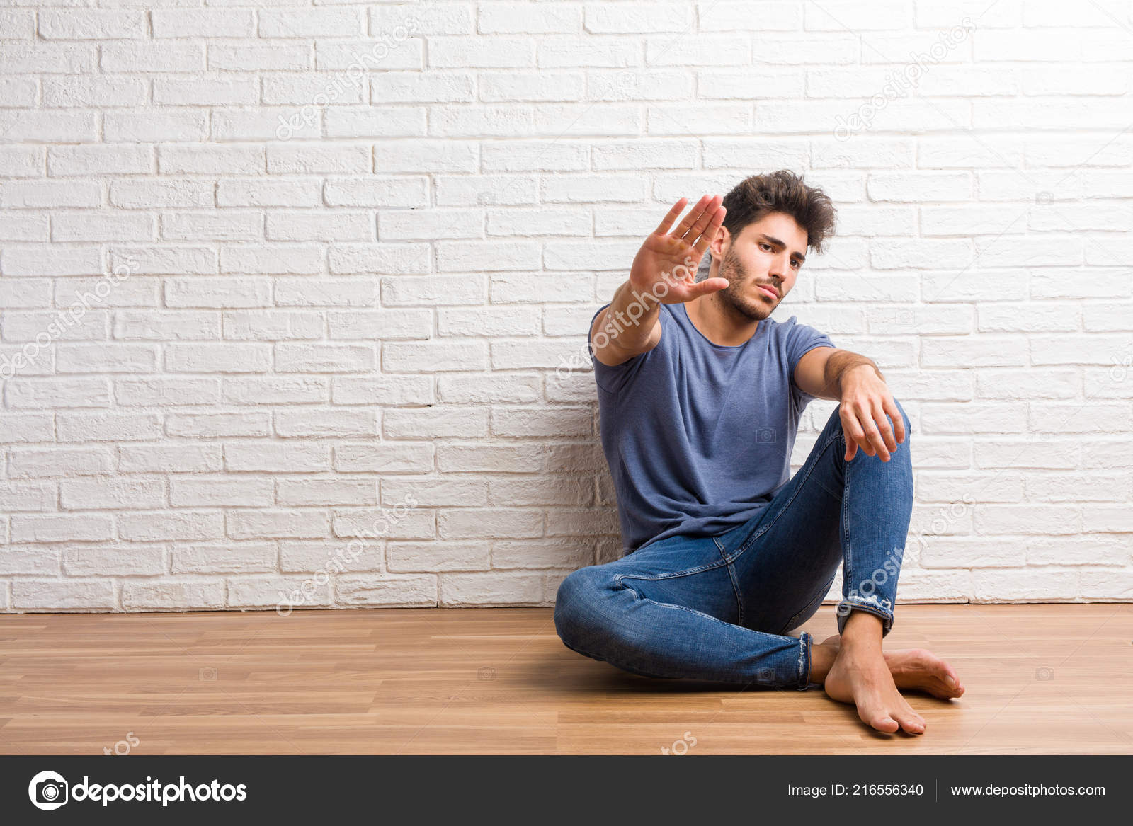 Young Natural Man Sit Wooden Floor