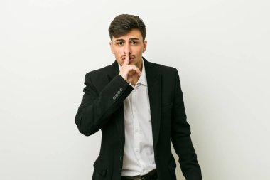 Young business hispanic man keeping a secret or asking for silence.