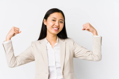 Young chinese business woman isolated showing strength gesture with arms, symbol of feminine power
