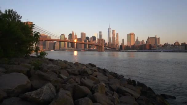 SLOW MOTION: downtown Manhattan View close to water with Brooklyn Bridge in Beautiful Sunrise Sunlight in Summer Water, Morning