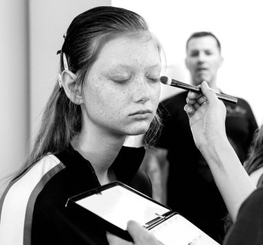 NEW YORK, NY - September 07, 2018: Sara Grace Wallerstedt prepares backstage for the Tory Burch Spring Summer 2019 fashion show during New York Fashion Week