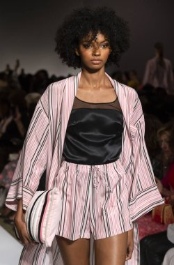 NEW YORK, NY - September 10, 2018: Djenice Duarte Silva walks the runway at the Dennis Basso Spring Summer 2019 fashion show during New York Fashion Week