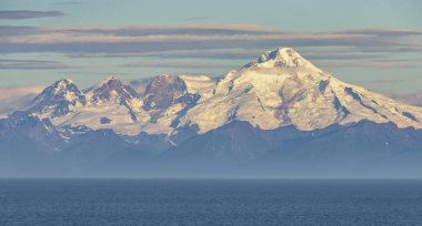 A view of the Chigmit Mountains, the northeastern section of Aleutian Range. The mountains are located across Cook Inlet on the west side of Kenai Peninsula.