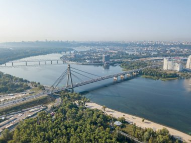 North bridge over the Dnieper river in Kiev. Aerial drone view.
