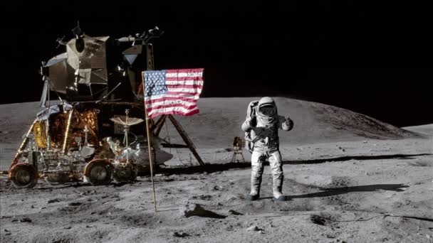 Astronaut jumping on the moon and saluting the American flag.. Some Elements of this video furnished by NASA.