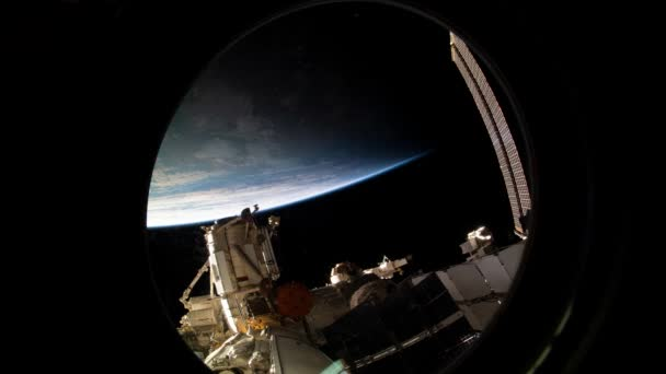 Earth as seen through window of International Space Station ISS. Docking spacecraft with ISS. Elements of this image furnished by NASA.