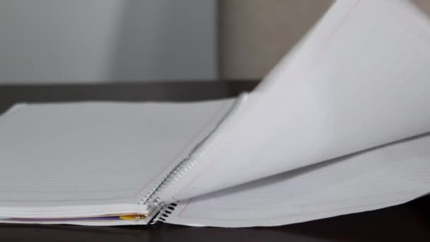 close up of a notebook with blank sheets moving because of the wind, home study concept