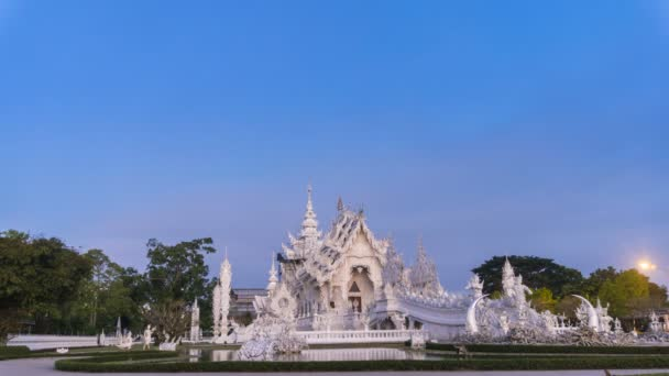Wat Rong Khun beautiful white temple famous landmark travel place and popular of Chiang Rai, Thailand in morning time 4K time lapse UHD.