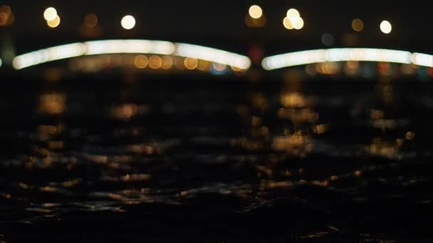River waves at night city. Saint Petersburg
