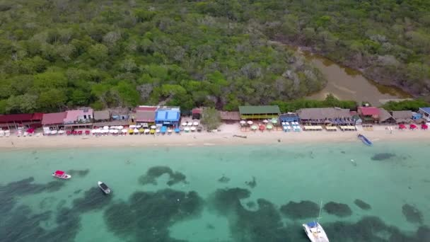 Lateral Traveling of White Beach at Baru Island, view of the coastline, Colombia