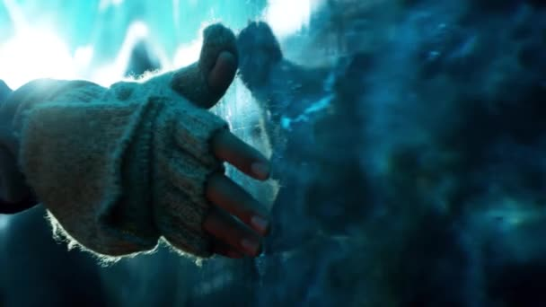 cropped footage of woman touching glacier ice