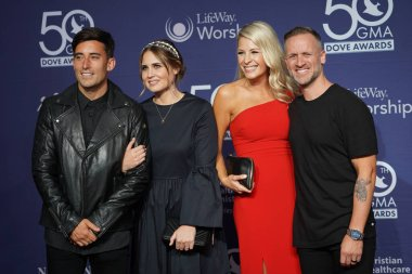 Christian Group Bethel Music (r) and Phil Wickham and his wife (l) Walk the Red Carpet at the 50th GMA Dove Awards at Linbscome University in Nashville, Tennessee on October 15, 2019.  Photo Credit:  Marty Jean-Louis