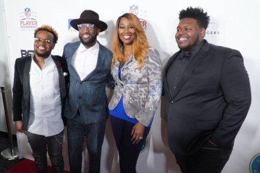Travis Greene, Rickey Smiley, Yolanda Adams and Melvin Crispell III pose for picture during the 21st Annual Super bowl Gospel Celebration Red Carpet at the James L Knight Center in Miami Florida on Thursday January 30, 2020.  Photo Credit:  Marty Jea