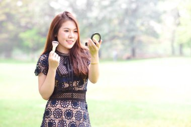 Beautiful asian women make up on face ,Natural background