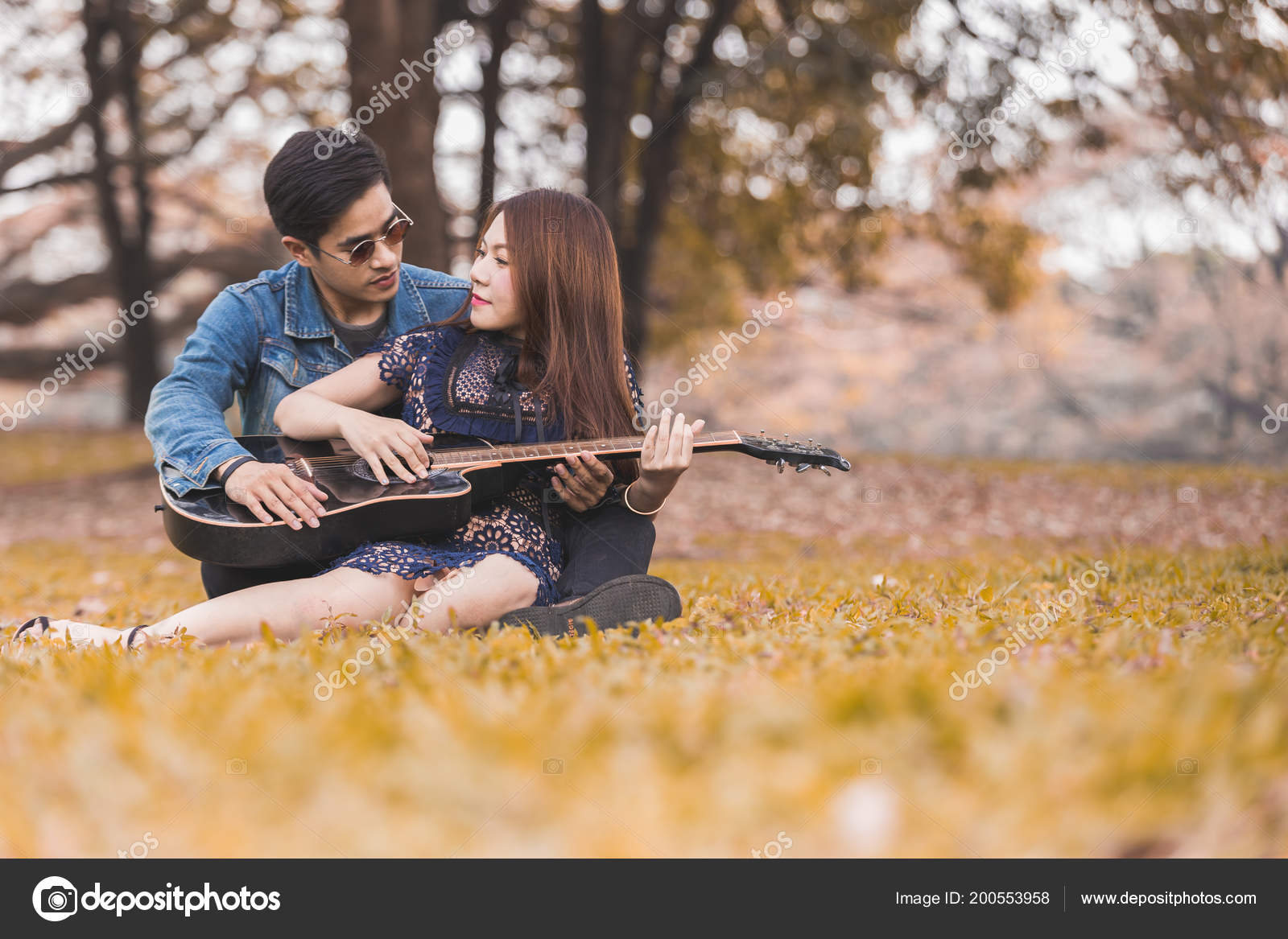 Asian Couple Love Playing Acoustic Song Guitar Sitting Grass