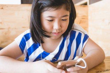 Asian little girl black hai