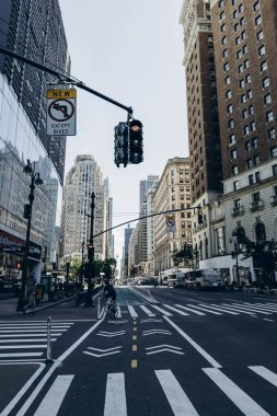 New York streets. Center of Manhattan. Empire State Building. New York street sign direction. Intersection pedestrian direction sign. High rise buildings of New York.