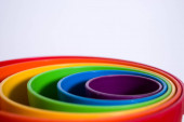 Colorful Abstraction - Rainbow colored, round plastic containers stackedby size: toys for kis to play with sand or water.