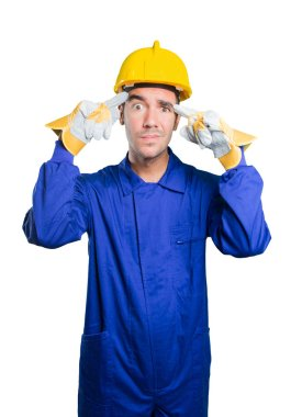 Worried workman with concentration gesture on white background