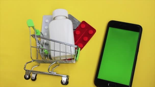 ordering goods and drugs online with delivery. green screen phone in frame