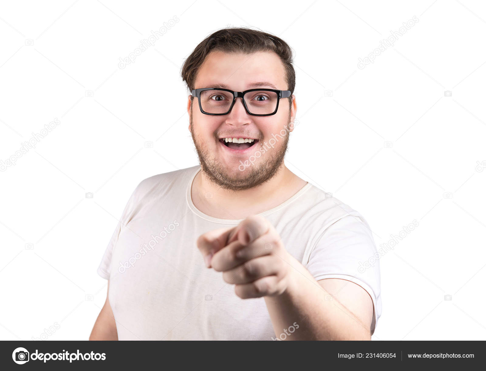 Cheerful chubby man in white t-shirt and glasses smiling and pointing at  camera isolated on white background– stock image