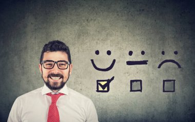 Confident happy business man received excellent rating for a satisfaction survey