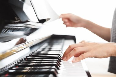 Classic piano key with musician hands playing