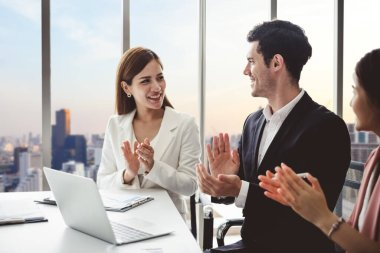 Business people clapping hands during meeting in office for their success in business work
