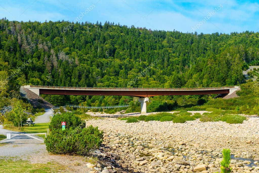View of the car bridge and suspension bridge of Big Salmon River, in Fundy Trail Parkway park, New Brunswick, Canada