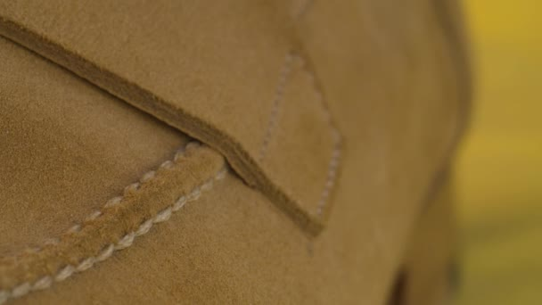 Seam on natural suede boot