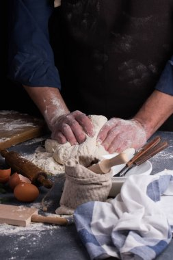Baker prepares the dough on table. Homemade pastry.