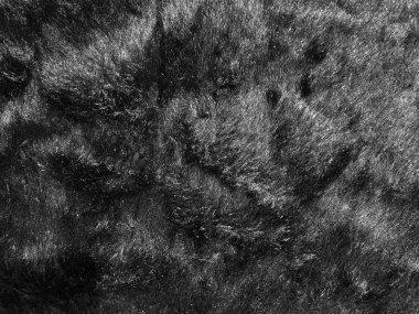 Black soft cotton sheep wool fluffy fur carpet texture backgroun