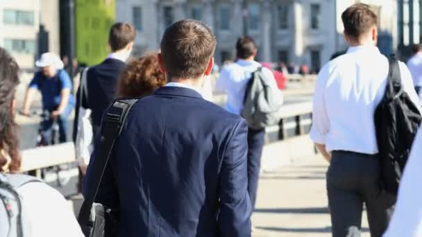 Rear View Of Businessman Walking To Work In Slow Motion