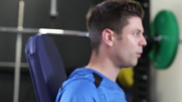 Slow Motion Sequence Of Man In Gym Exercising With Weights