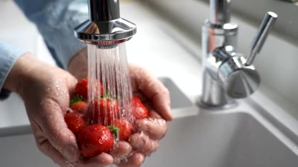 Close Up Man Washing Fresh Strawberries Under Tap
