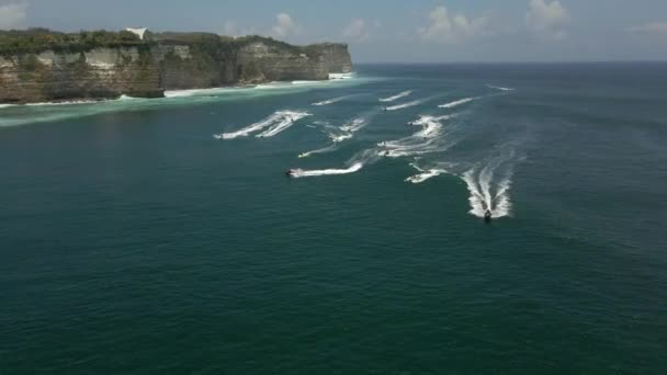 Aerial video of people driving the jet ski in the beautiful light-green waters.