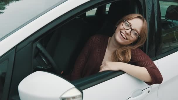 Close up, Face expression of young caucasian woman sitting on the driver seat and leaning to car doors