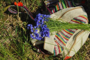 Backpack and some flowers.
