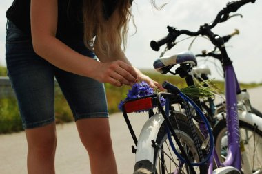 Gril riding on the bike.