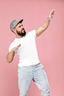 bearded man in cap dancing