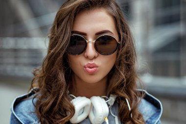 woman with headphones and sunglasses