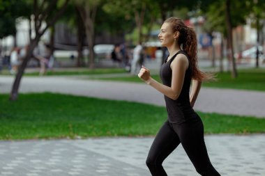 young attractive woman running
