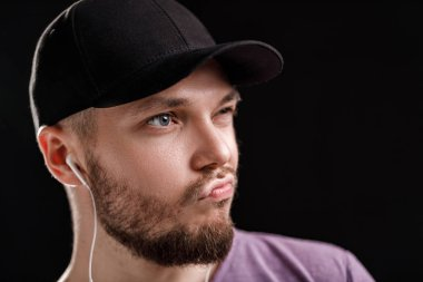 the man listening to music in headphones