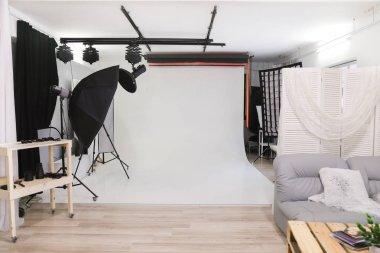 Empty photo studio with professional lighting equipment. interior stock vector