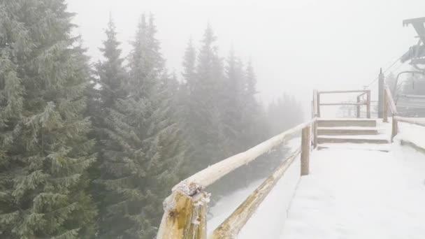 BUKOVEL, UKRAINE - January 29, 2018: skiers and snowboarders climb the ski lift, on January 29, 2018 in Bukovel, Ukraine