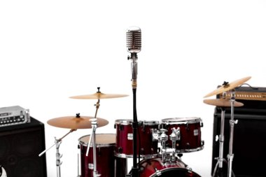 Microphone in a recording studio with drum on background.