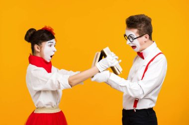 portrait of mime couple artist with book